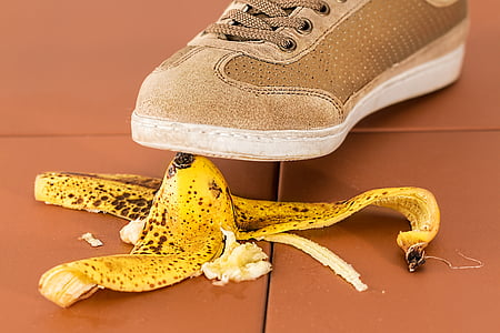 banana peel under person shoe