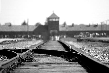 grayscale photo of train rails