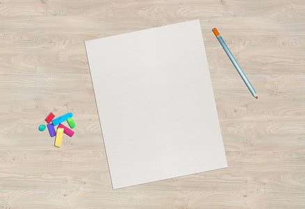 white piece of paper on gray top table