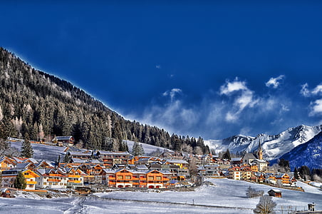 village covered with snow during daytime