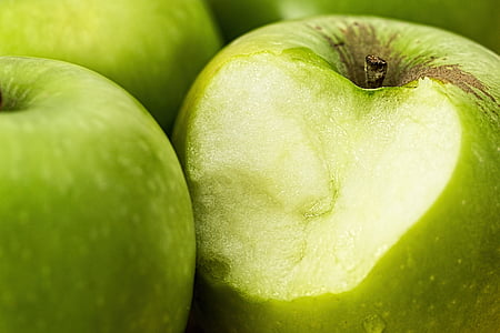 macro photography of green apples