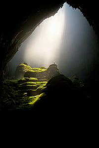 grass covered cave