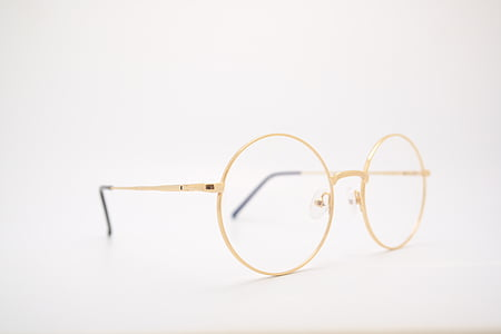 eyeglasses with gold-colored frames