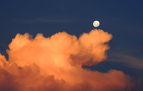 view of nimbus cumulus clouds with full moon