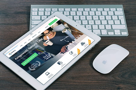 white iPad, white Apple magic mouse and wireless keyboard