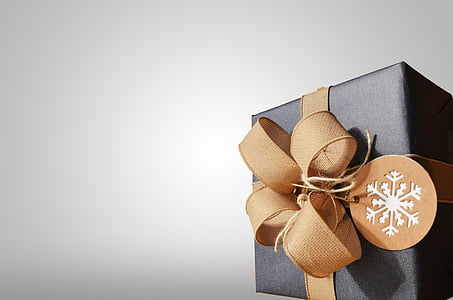 square black gift box with brown bow