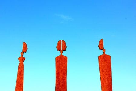 three red human statues