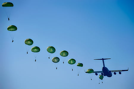 blue airplane and green parachutes