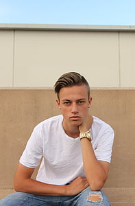 man wearing white crew-neck shirt and silver watch