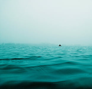 man sailing on body of water