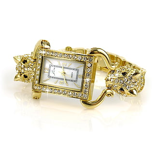 rectangular gold-colored analog watch with clear gemstone