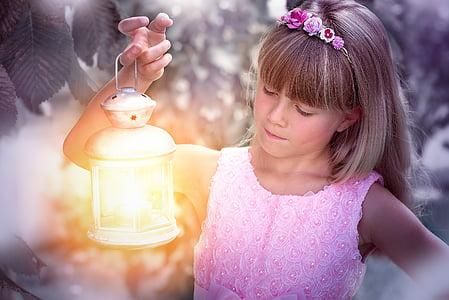 girl carrying lantern