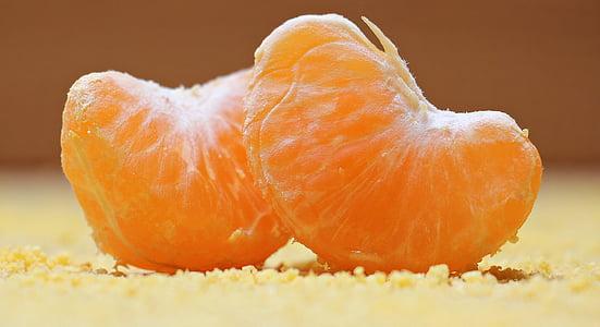focused photo of two slices of oranges
