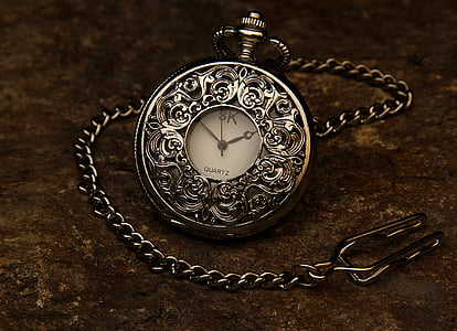 silver-colored pocket watch with link strap