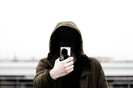 man wearing brown hoodie photography