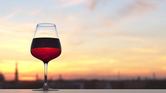 focused photography of red wine in wine glass