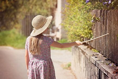 woman wearing brown pandora hat