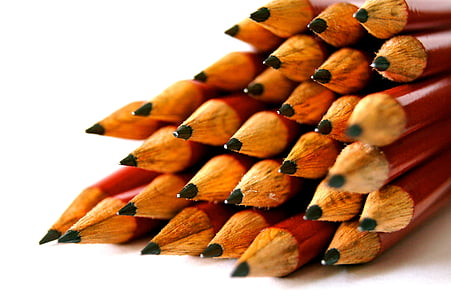 selective focus photography of pile of pencils