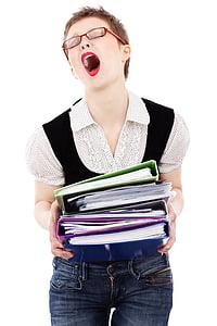 woman carrying file folders