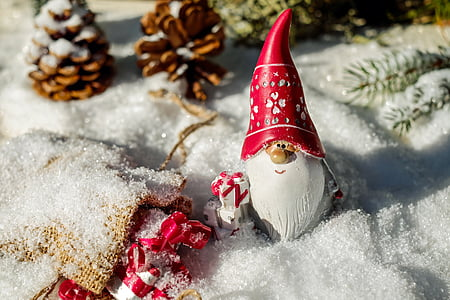 gnome Santa figurine on snow ground