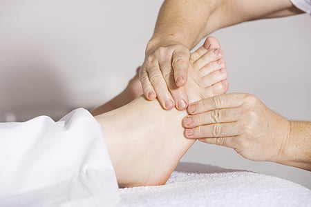 person massaging another person's right foot
