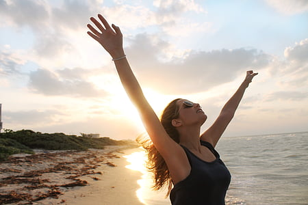 woman wearing black tank top in the beach