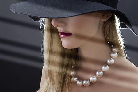 women's white beaded necklace