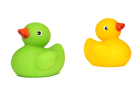 green and yellow rubber ducklings