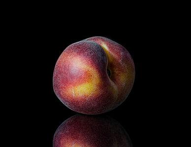 crisp apple on black surface