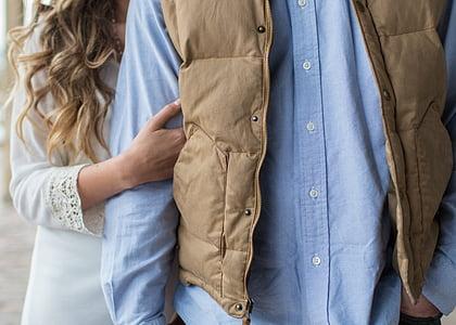 person wearing brown full-zip jacket