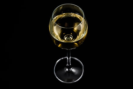 photo of wine glass with liquor