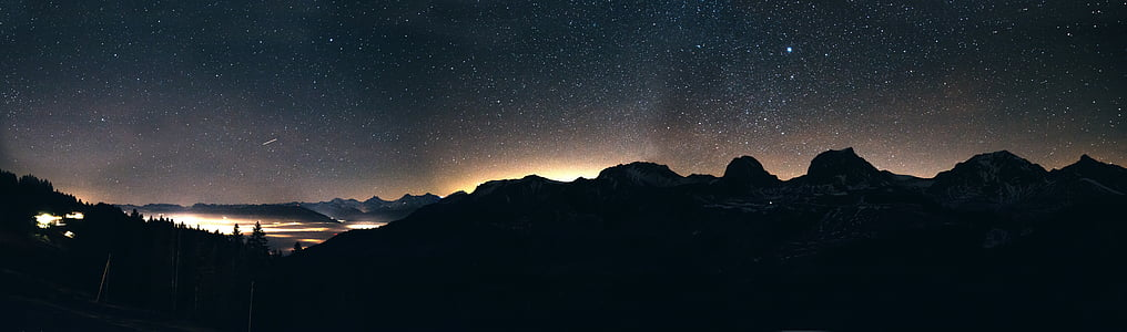 panorama photo of mountain with trees during nighttime