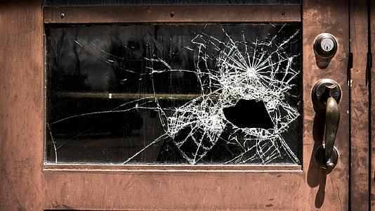 broken glass in wooden door