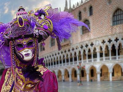 person wearing purple masquerade mask