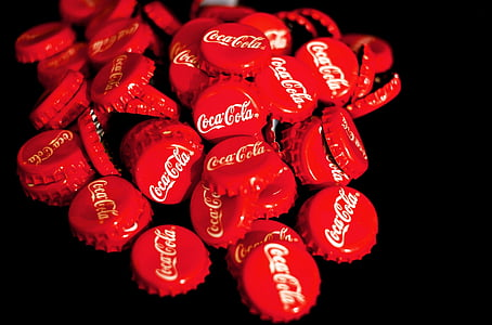 pile of red Coca-Cola bottle crowns