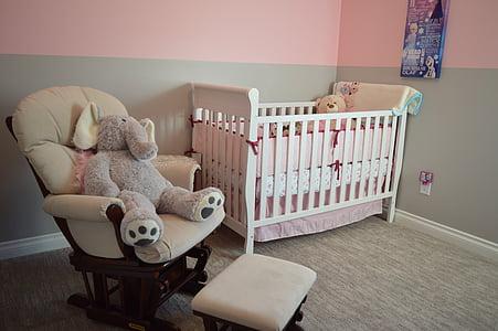 glider chair beside crib