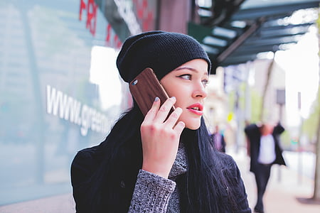 woman holding smartphone