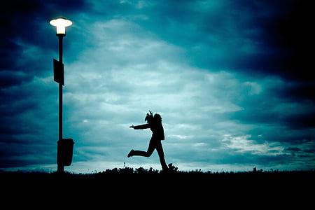 person standing near street light