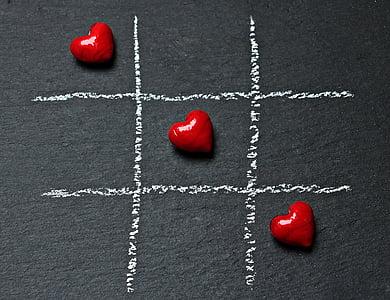 three red heart stones