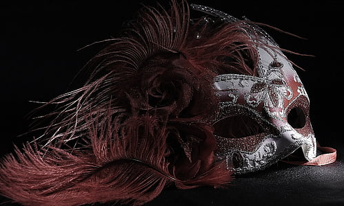 women's white and red mask