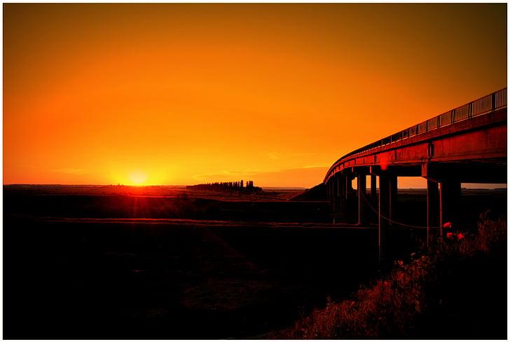 photo of bridge during sunset