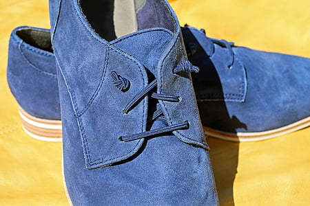 pair of blue suede shoes