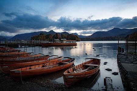 several wooden boats on seashore