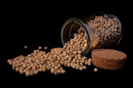 clear mason jar with seeds