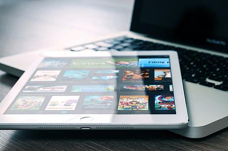 white iPad Pro on MacBook Pro