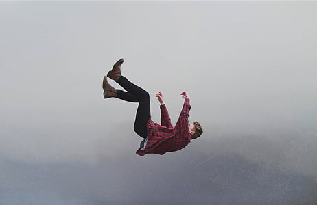 man falling from the skies during daytime