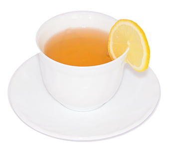 white ceramic teacup with lemon tea