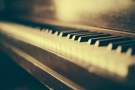 shallow focus photo of black and white piano