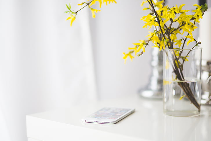 white smartphone on white table
