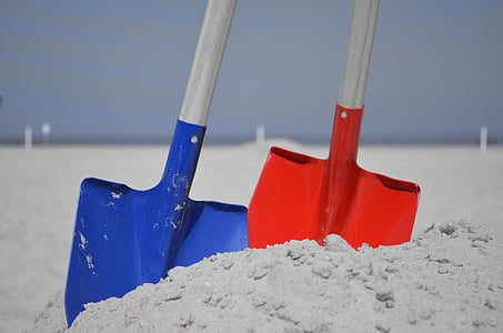 two blue and red shovels